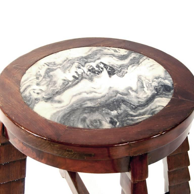 This round marble top stepped leg table was crafted by hand of esteemed rosewood in 1920s Shanghai. The design was heavily influenced by the Art Deco movement in the West that was brought to China by Europeans during the economic boom of the early
