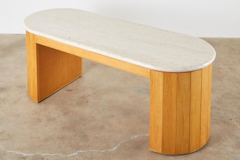 Monumental executive desk or pedestal desk with demilune ends. This writing desk features a massive 1.5 inch thick slab of polished marble. The slab is mounted to a comforming base with decorative panels covering the half round ends. Centered on the