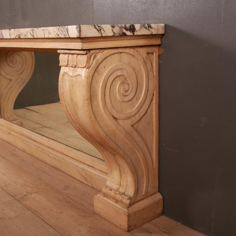 Stunning 19th century marble topped console table made from 18th century component. Measures: 1.5