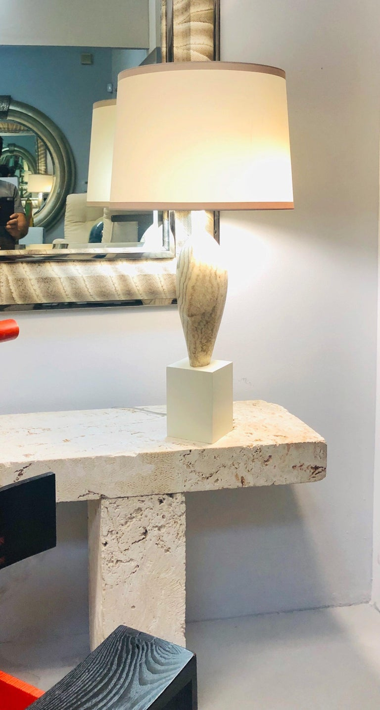 A substantial lamp by Marbro. Wood base supports a solid marble element. 2 bulb cluster. Newly wired. Shade is not included.