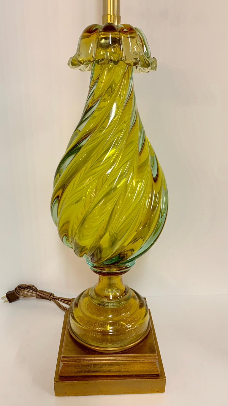 Italian Seguso glass lamp by The Marbro Company. This high quality lamp firm specialized in finding unique and special pieces of porcelain and glass and made lamps out of these pieces. The glass is in a few sections and is approximate 20 inches tall