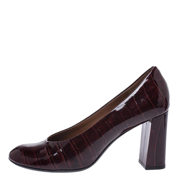 These pumps have been designed to accompany your style with ease! The shoes are a result of blending the comfort factor with minimal design elements. Crafted using croc-embossed patent leather, the block heel pumps featuring round toes are from Marc