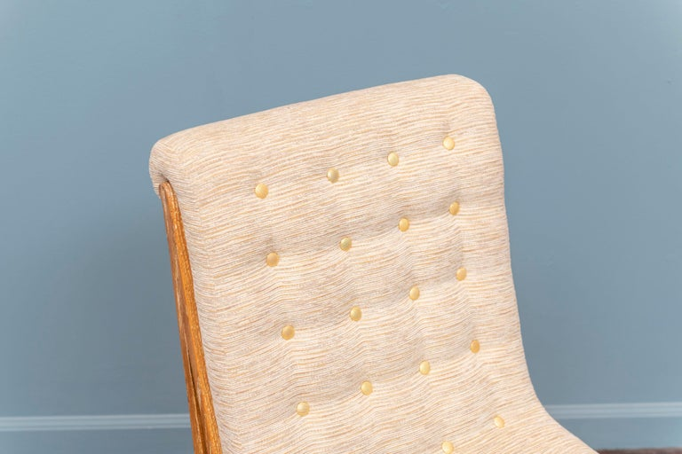 Marc du Plantier style slipper chair in limed oak with chenille fabric and gold buttons.
