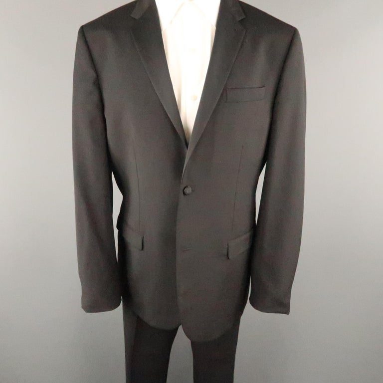 4c0b2e0dafd MARC JACOBS tuxedo comes in a black wool / mohair featuring a notch lapel,  flap