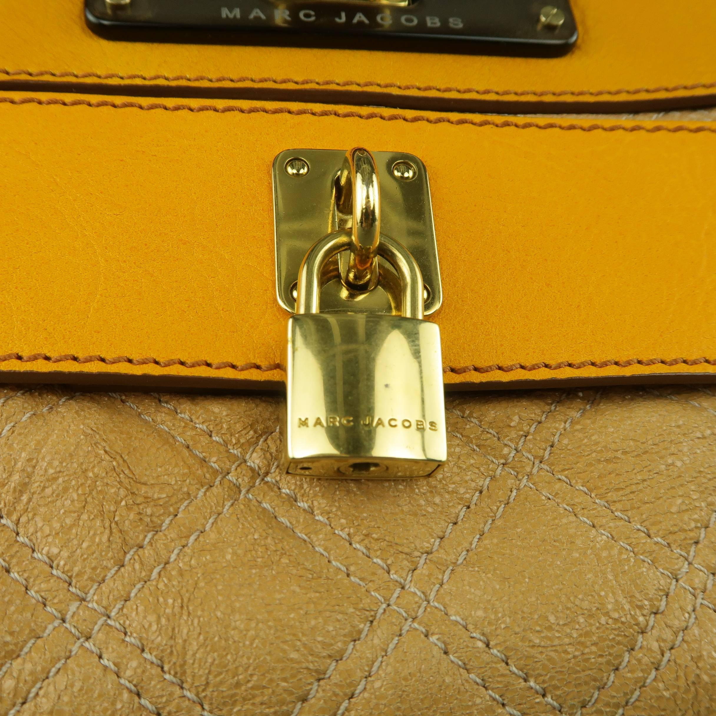 2f32f2ba931a MARC JACOBS Beige and Gold Quilted Leather Lock Clutch Handbag For Sale at  1stdibs