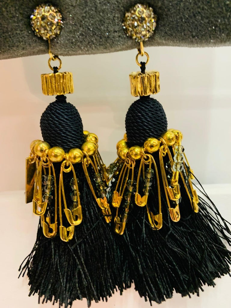 Black and Gold Marc Jacobs metal clip earrings and Swarovski crystals. Length 11 cm. With original box.