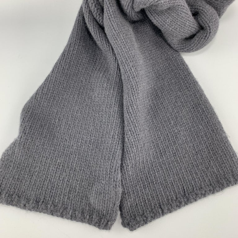 MARC JACOBS scarf comes in navy cashmere knit in a long rolled shapes.  Good Pre-Owned Condition.  90 x 8.5 in.