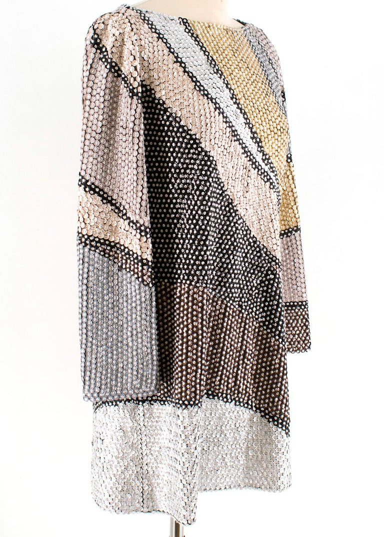 Marc Jacobs Sequin Studded Shift Dress   Multicolour pattern sequin dress Gold, brown, silver and black diagonal stripe design  Long sleeves Wide crew neck  Brown interior lining  Hidden zip fastening at the back centre of dress  Loose fit  Straight
