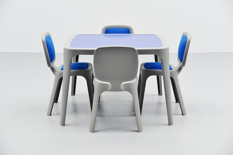 Nice contemporary 'Coast' dining set designed by Marc Newson and manufactured by Magis, Italy, 1995. The set is made of grey plastic and the top of the table is made of blue laminate. And the chairs have blue wool upholstered seats and backs. Very