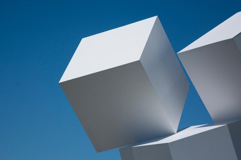 Impossibly balanced, these three white cubes form one monolithic outdoor structure. At night the sides of the cubes appear as free-floating diamonds. This painted, aluminum sculpture is stone white. It is available by commission.  This is number 3