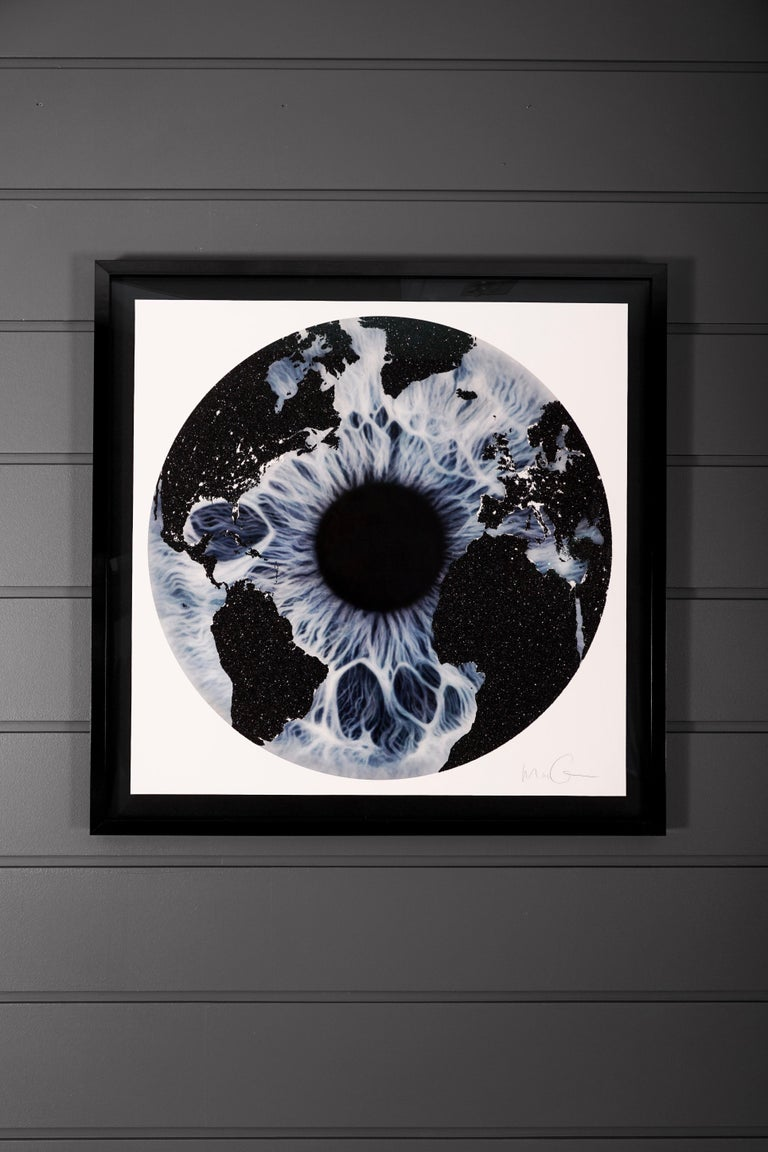 'Blue Iris with Diamond Dust', created in 2019 by Marc Quinn. The piece features a blue iris with an overlay of a world map covered with a brilliant layer of shimmering Diamond Dust. This silkscreen print is an exclusive edition of only 15. The