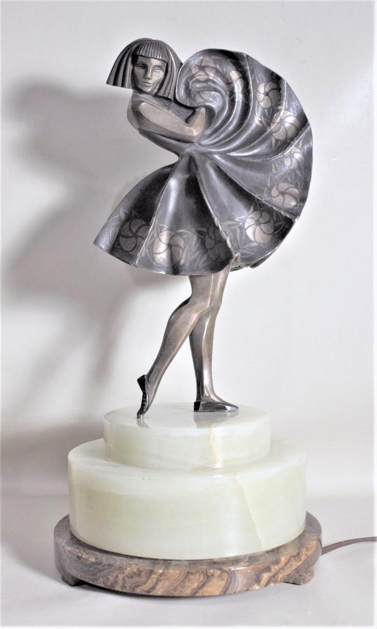 This rare and extremely well executed bronze statue was done by the highly renowned French artist Marcel Andre Bouraine in circa 1925 in the period Art Deco style. This bronze is known as 'Dancing Girl' and depicts a stylized female figure with a