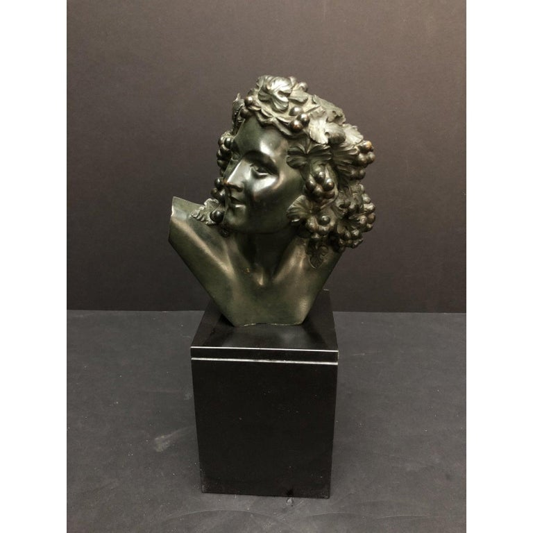 Marcel-André Bouraine (1886-1948) Bronze Bust Sculpture. Fine quality period Art Deco bronze bust by celebrated sculptor Marcel-André Bouraine. Mounted on an original Belgium black marble base. Beautifully sculpted female with hair dressed with