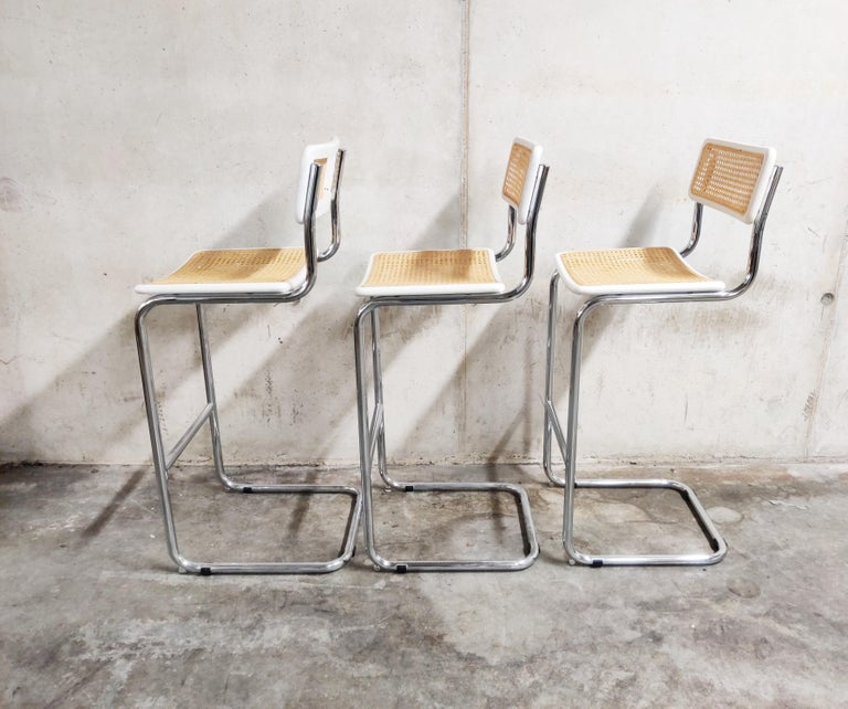 Set of 3 Marcel Breuer Bauhaus design bar stools produced by Cidue.  Tubular chrome frame with cane seats.  All in very good condition.  Dimensions: Height 93cm/36.61