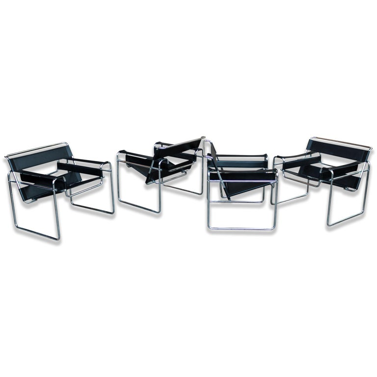This set of 4 black leather Wassily chairs was designed in 1925 by Marcel Breuer and manufactured by Gavina, 1972. Inspired by the frame of a bicycle and influenced by the constructivist theories of the De Stijl movement, Marcel Breuer was still an