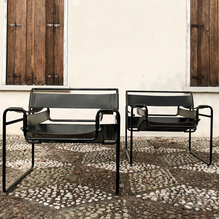 A pair of grey leather Wassily chairs, designed in 1925 by Marcel Breuer and manufactured by Gavina, 1972.