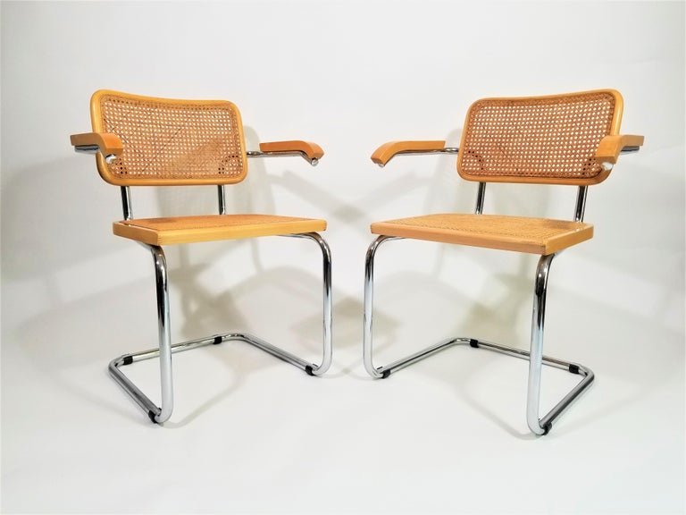 Stunning pair of midcentury Marcel Breuer Cesca armchairs in natural finish. Cane seats and backs. Classic chrome cantilever frames. Caning intact. We polish all chrome. Black protectors on chrome are removable.
