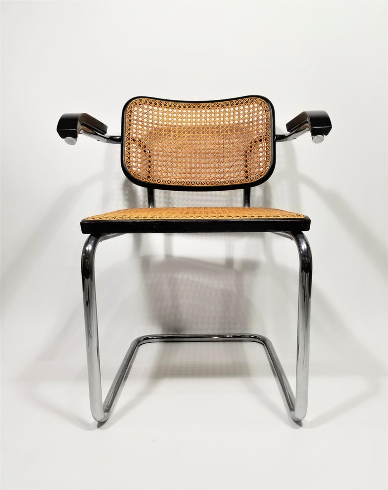 Rare authentic midcentury 1960s production Marcel Breuer Cesca armchair with black finish by Stendig. Hand caned seat and back. Signed with original marking stickers on both seat and back. Classic chrome cantilever frames.  Complimentary delivery in