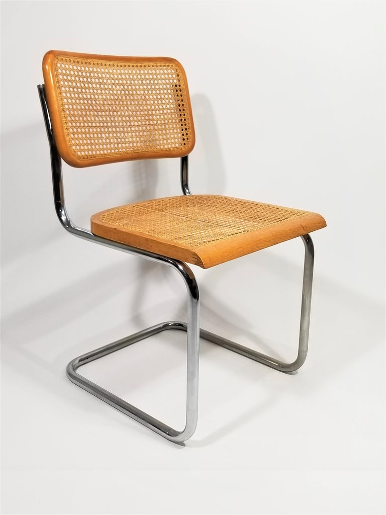 Mid century 1970s Marcel Breuer cesca side chair. natural finish. Cane seat and back. Classic chrome Cantilever frame.