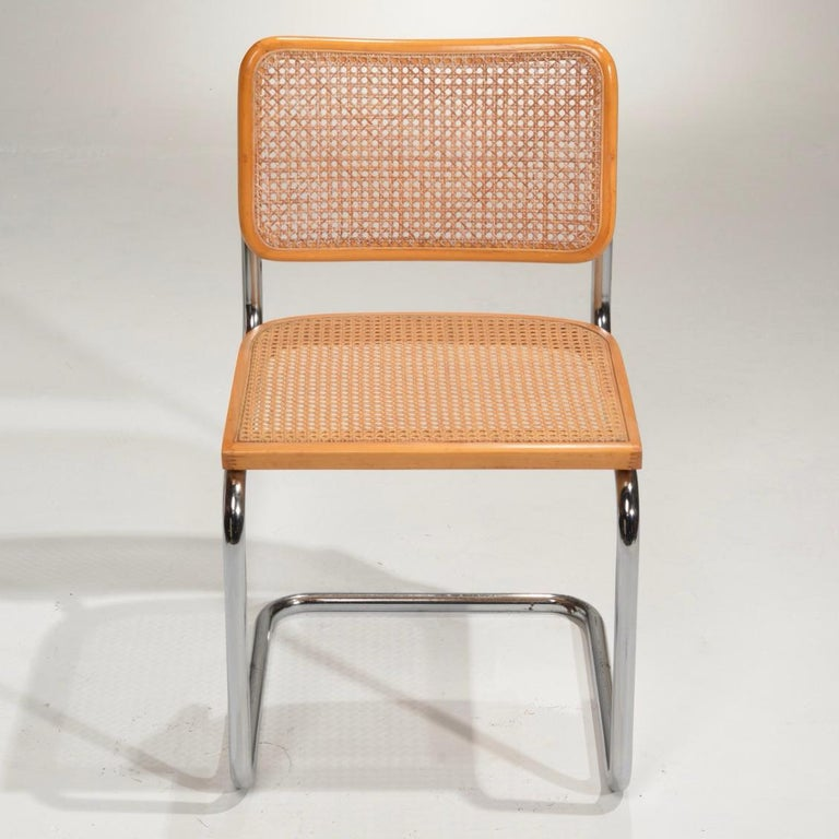 Marcel Breuer Cesca side chairs in natural finish. Cane seats and backs. Classic chrome cantilever frames.