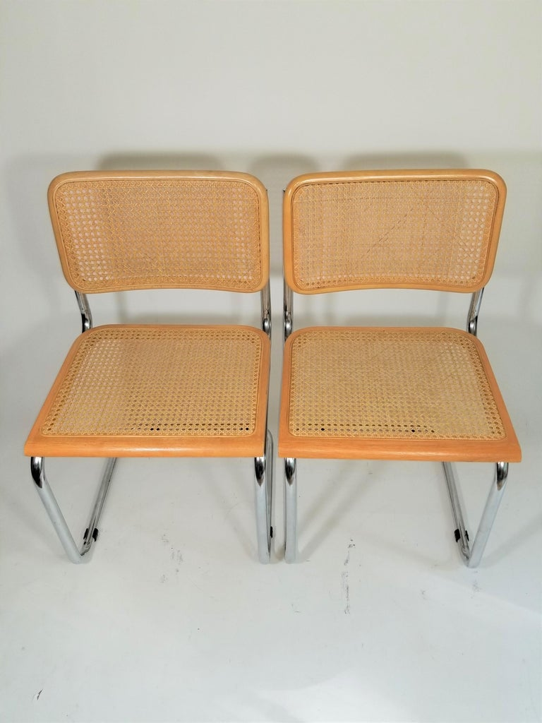 Midcentury pair of Marcel Breuer Cesca side chairs. Cane seats and backs. Classic chrome tubular steel frames.