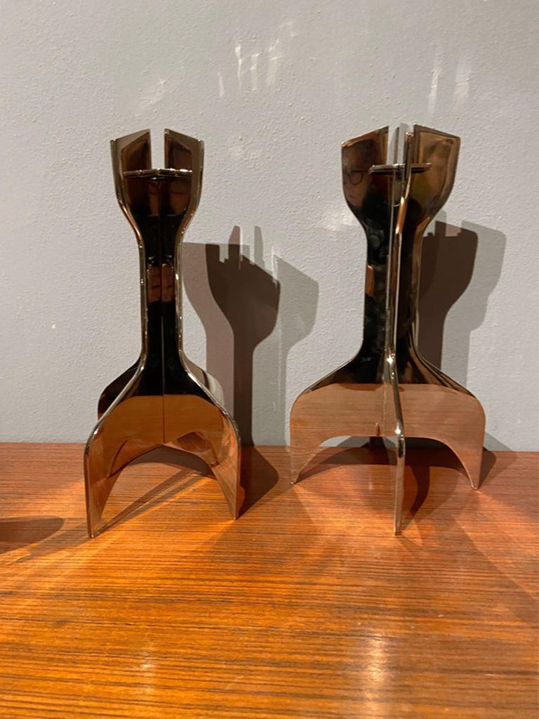 Italian polished steel candle holder designed by Marcel Breuer and manufactured by Gavina with adesive label of manufacturer, 1980s. The candle holder consists of three interlocking elements.
