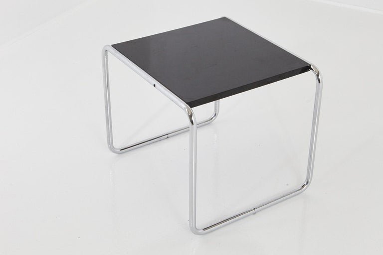 Marcel Breuer 'Laccio' modern side table, the top in black laminate with an MDF core and mounted on a chromed tubular steel frame. The table dates probably from the 1970s or 1980s. The black laminate in that form doesn't exist anymore, on the