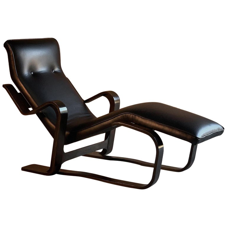 Marcel Breuer long chair chaise lounge attributed to Isokon, circa 1970 Bauhaus  Marcel Breuer 'Long Chair' ebonized bent ply with black leather seat pad by Isokon circa 1970s, the 'Long chair', with its bent frame of laminated birch wood supporting