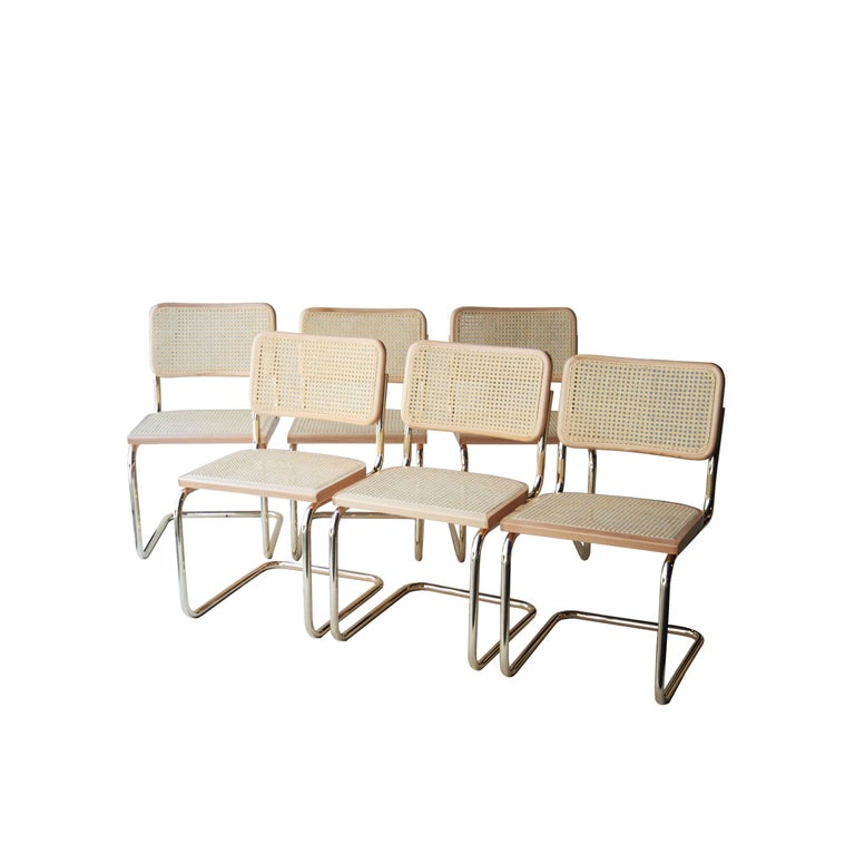 Set of 12 Cesca chairs designed by Marcel Breuer in 1962 and produced in Spain during de 1960s by Yco under the license of Gavina. Brassed tubular structure, oakwood frame with braided natural fiber seat and back.