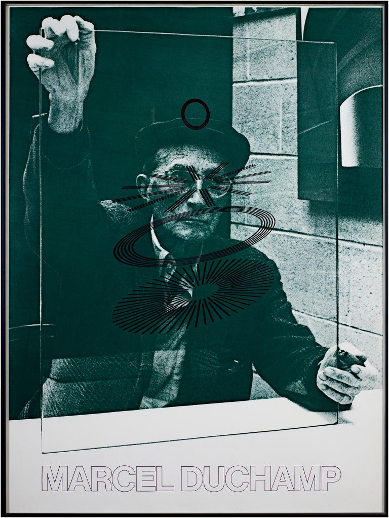 """The Oculist Witness"" is a poster by Marcel Duchamp. It features a self-portrait photograph of the artist behind a glass with circular patterns. The photograph has a green tint.   31 3/8"" x 23"" poster 31 3/4"" x 23 1/4"" frame  Marcel Duchamp (28 July"