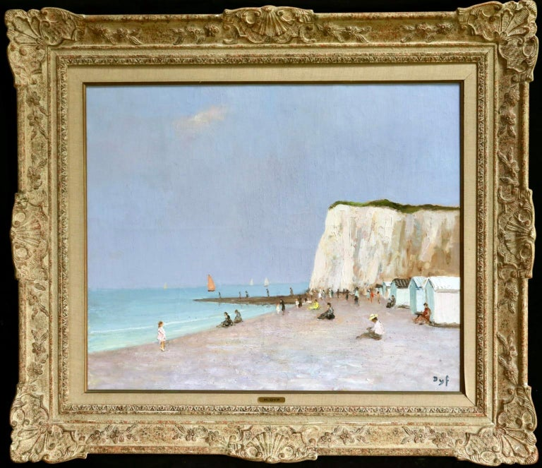 A lovely oil on canvas circa 1960 by sought after French post impressionist painter Marcel Dyf depicting bathers at the seaside - huts line the beach with cliffs behind and sailing boats out at sea. Signed lower left.  Dimensions: Framed:
