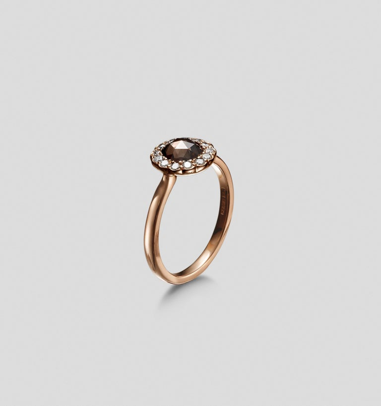 This gorgeous rose gold ring is part of the Zahr collection.  It blends colour and shapes.  With a diamond shaped basket underneath, this ring has all the elements of a well made and designed piece of jewellery.  It can be worn as an engagement or