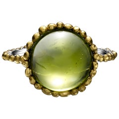 Round Cabochon Peridot Ring set in Platinum and 24 Karat Gold
