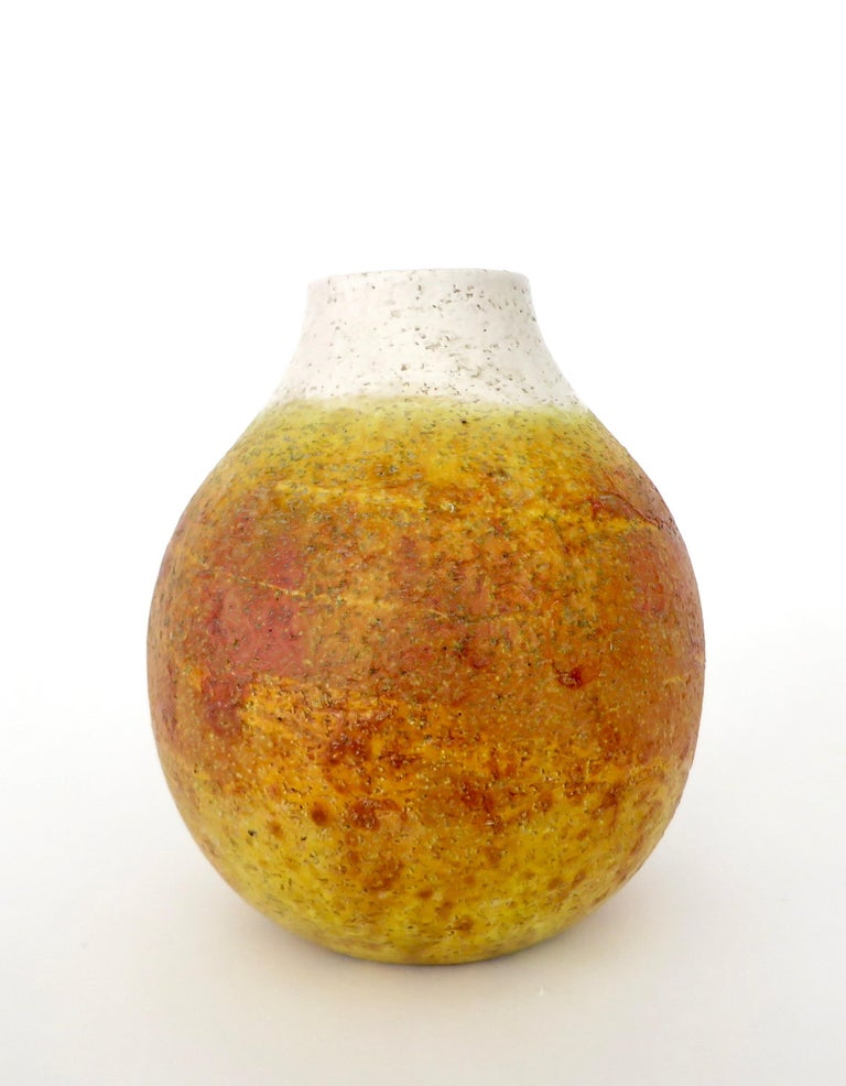 Marcello Fantoni ceramic vessel vase. Signed on bottom Fantoni, Italy.  A generous rounded form with a white glaze at the neck and orange yellow glaze covering the remainder of the vase.