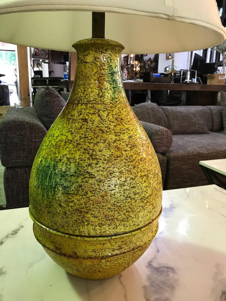 Beautifully designed and textured yellow green glazed studio ceramic lamp by Italian ceramics master or designer Marcello Fantoni for Raymor. Very rare and hard to find style and color. Would be stunning in any setting.  Signed on the