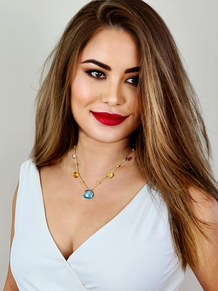 18K yellow gold short graduated necklace with tabeez cut multi-colored semi-precious gemstones set in 18 carat yellow gold. A timeless and playful Marco Bicego classic, this Paradise Multicolor Gemstone Necklace is hand engraved by Italian artisans