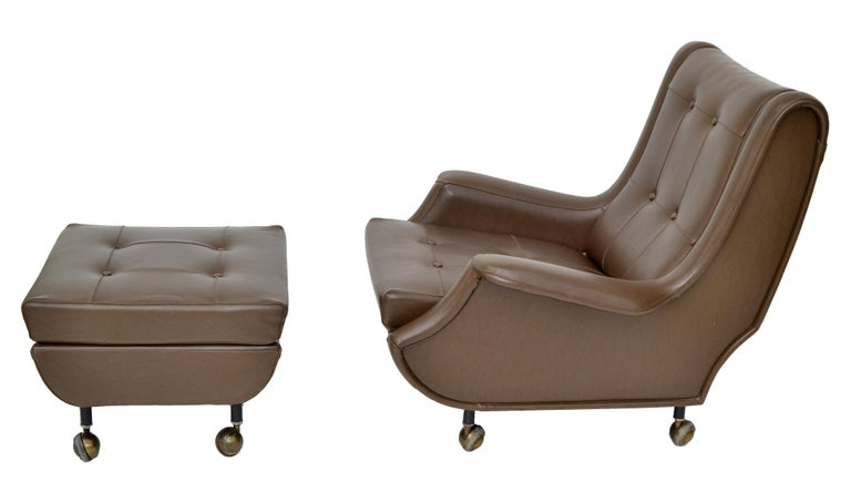 Exceptional chair and ottoman designed by Marco Zanuso made by Arflex, Italy.  Original brown leather, chair and ottoman on casters. Measures: Chair 33.25 H, 33 W, 27 D, 15.5 seat height, 21 W seat interior, Arm Height: 18.25 inches.  Ottoman: 22