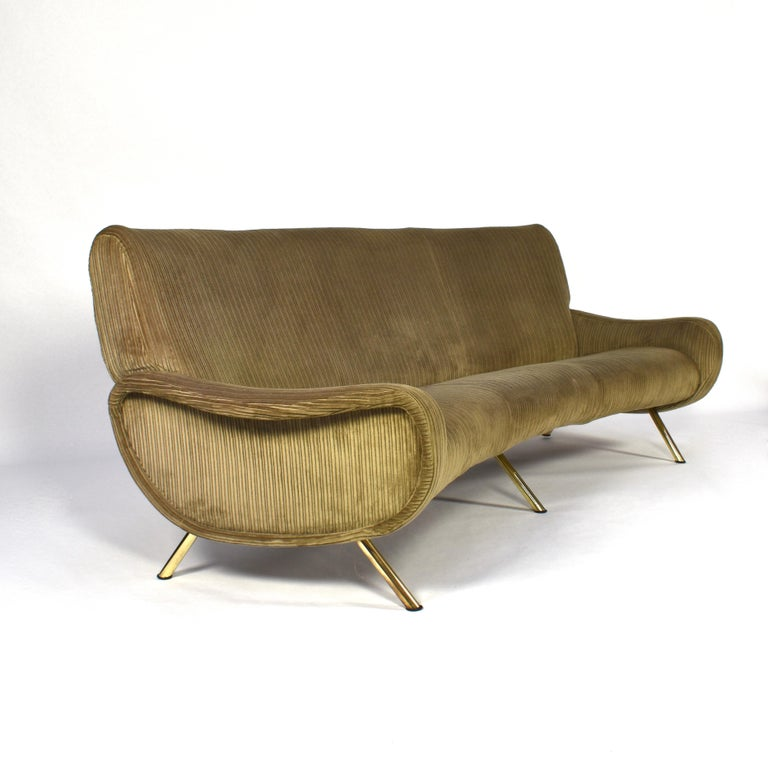 Rare and exclusive curved sofa by Marco Zanuso for Arflex, Italy, 1951. The sofa still has its original green rib corduroy velvet fabric and features brass legs. The sofa does not need to be reupholstered but is open for customization: the sofa can