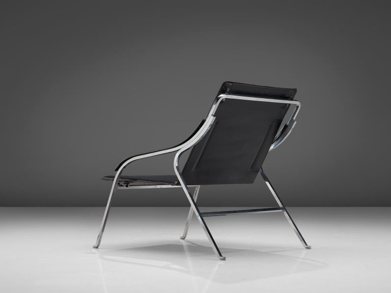 Marco Zanuso for Arflex, black leather and steel, Italy, 1964.  This lounge chair by Zanuso remains among the best examples of armchairs designed by the architect. It is not only the ingenious slender design that distinguishes it, but also the
