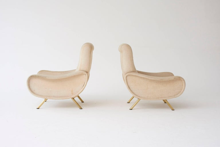A pair of original Marco Zanuso Lady chairs, Arflex, France/Italy, 1960s. The fabric is a bit dirty so the price here includes recovering in customer supplied material.  Ships worldwide - please contact us for options.