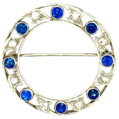 """Marcus"" Art Deco Yogo-Montana Sapphire and Diamond Circle Brooch"