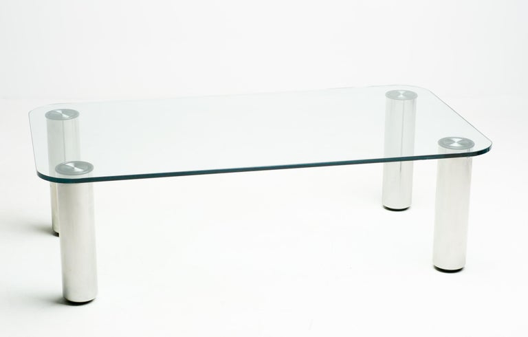 Glass coffee table designed by Marco Zanuso with glass top and detachable stainless steel legs.