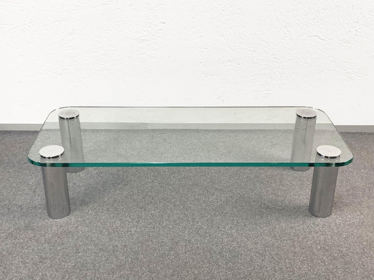 Marcuso coffee table designed by the famous Italian architect Marco Zanuso for Zanotta, with very thick glass top, original supported by four chrome-plated screws on legs. Documented in the Repertoire by Giuliana Gramigna for the Mondadori