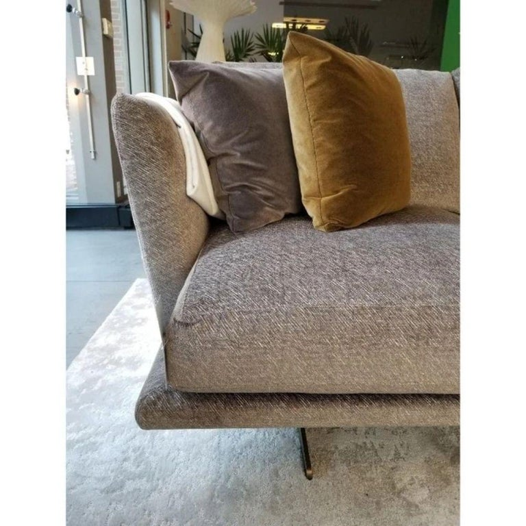 Designed By Stefano Gallizioli  Modular Sofa, characterized by a refined and modern design and by extremely high seating comfort.  9CLP208   Fabric CAT G Casamance  Base Brushed Antique Gold Metal  This is a showroom floor sample.