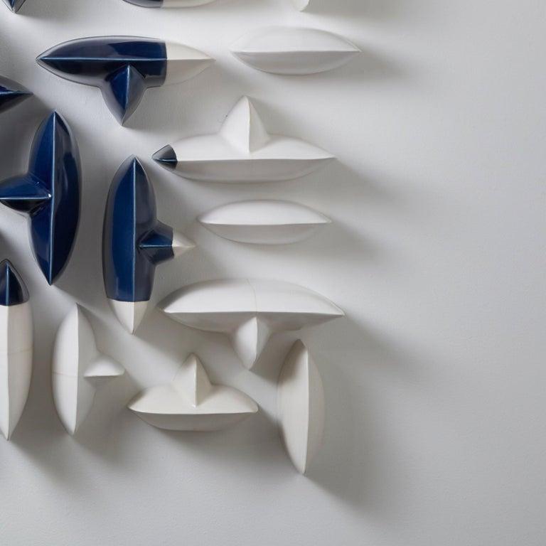 Blue and white ceramic porcelain wall sculpture installation by Maren Kloppmann 4