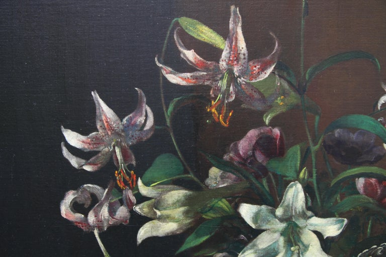 A large oil on canvas of a stunning floral arrangement by female artist Margaret Evangeline Wilson. Wilson exhibited at the Paris Salon and won the Medaille d'Or at the Paris Salon in the 1930's. This painting dates to the 1920-1930s and is a