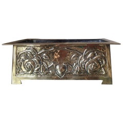 Margaret Gilmour, Attributed a Glasgow School Brass Planter with Stylised Roses
