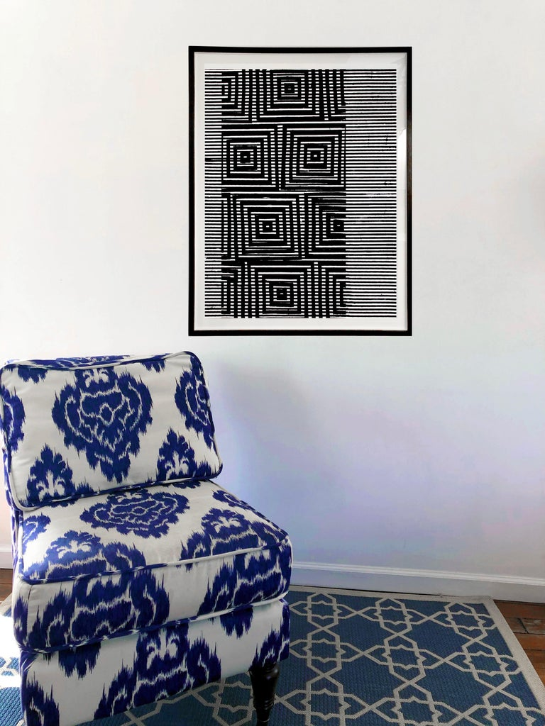 In this vertical painting in acrylic and silver mica on handmade Indian paper, graphic lines and geometric shapes create an eye-catching, layered black pattern on the white background. Signed by artist on the verso. Price shown is the unframed