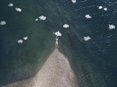 Cumulus - Woman figure floating in ocean water, beach coast, plastic bag clouds