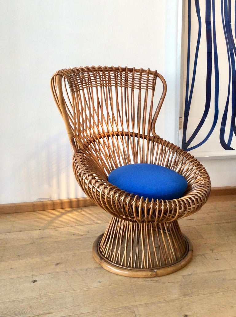 For Vittorio Bonacina, Como. Woven bamboo and rattan, with new cushions. Lovely, warm, deep honey patina to the rattan. Measures: Chair H 92.5 / W 85 / D 72 cm Footstool Height 32 / Diameter 66 cm Illus. 'Repertorio 1950-2000', Vol. 1, p.